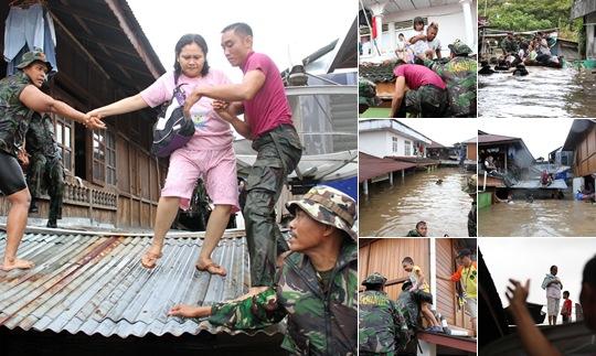 View Evakuasi Warga Terjebak Banjir di Manado